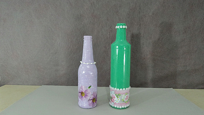 garrafa de vidro com perolas
